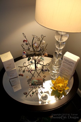 "My ""tree"" display featuring a selection of PhoenixFire Designs tree of life pendants and bird nest pendants on display for purchase in the lobby!"