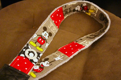 A Mickey DSLR camera strap from Rebecca & Tim