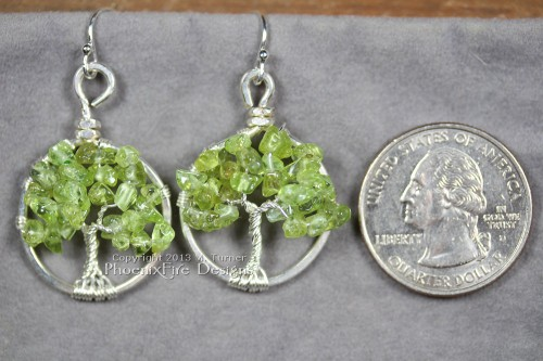 This pair of dainty Tree of Life earrings features genuine, natural Peridot gemstones and hangs on .925 sterling silver French ear wire hooks. Miniature tree of life pendants!