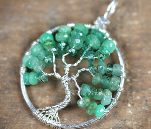Stunning shaded ombre emerald rondelles in silver wire make up this handcrafted, wire wrapped Tree of Life Pendant featuring May's precious gemstone birthstone. Artisan jewelry by PhoenixFire Designs.