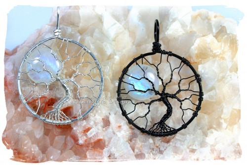 Stunning large natural blue flash rainbow moonstone full moon tree of life pendants in your choice of eco-friendly reclaimed and recycled solid Argentium sterling silver or striking black wire. By PhoenixFire Designs and available on etsy.