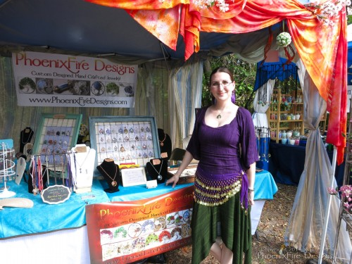 Me! (Miss M. Turner) of PhoenixFire Designs in front of my booth for the second week in a row on the final weekend of the Bay Area Renaissance Festival, April 2014