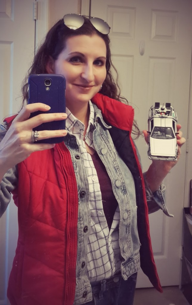 Teaser shot: me in my female Marty McFly Cosplay costume holding a miniature DeLorean time machine... to be continued.