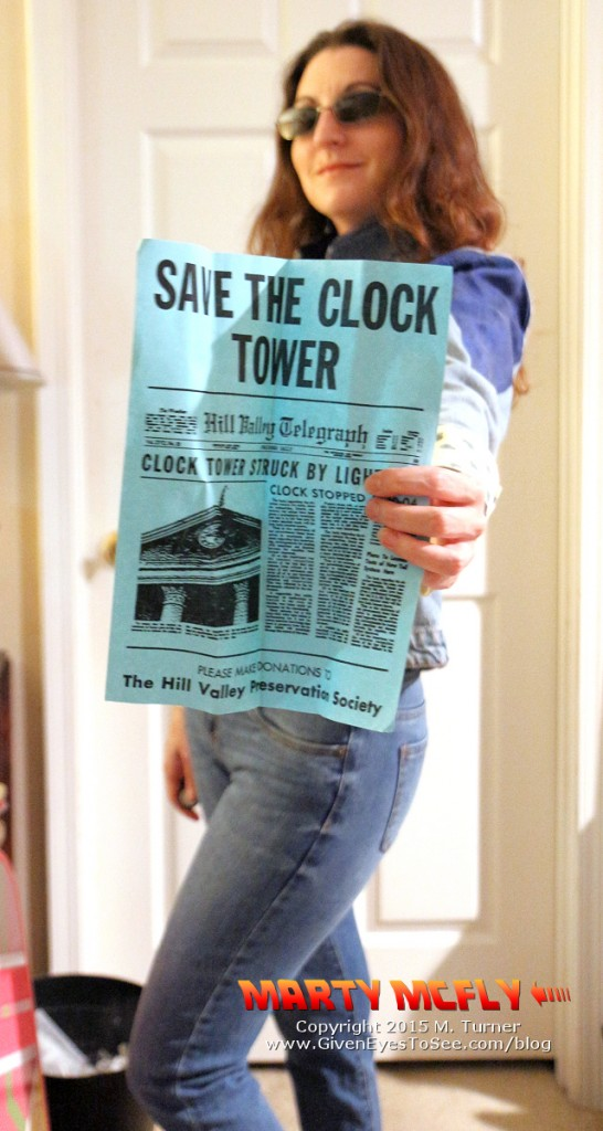Save the Clock Tower! (Me in my female Marty McFly cosplay showing off a copy of the famous flyer that explains how lightning struck the clock tower at precisely 10:04pm November 12, 1955.)