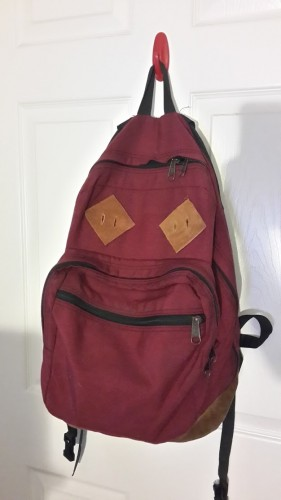 "I made minor modifications to a vintage Jansport backpack to give it the look of Marty's Eastpak. By getting the maroon color with suede bottom and adding some leather ""pig ear"" patches, it looked really good for very tiny investment."